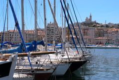 Port of Marseille. With boats in the foreground,buildings and basilica in background Royalty Free Stock Photography