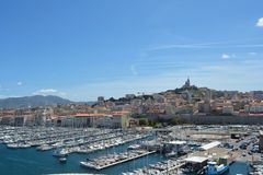 Port of Marseille, France. Blue sky and the town at the background. royalty free stock images