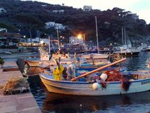 The Port of Massalubrense. Village, just after Sorrento, with fishing boats moored at the dock at sunset stock photography