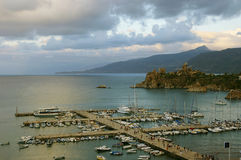 Port of medieval town. Touristic port of medieval town Cefalu in Sicily royalty free stock images