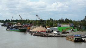 Port at Mekong River. Cranes working, loading and unloading ships and truck. Editorial: Ca Mau, Vietnam, 20th May 2016. Small port at Mekong River. Cranes stock footage