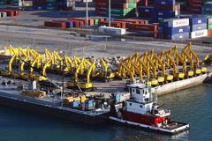 Port of Miami. Tug boat moared with a backdrop of machinery and cargo containers Royalty Free Stock Image
