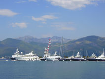 The port of Montenegro. Yachts in the port of Montenegro against mountains Royalty Free Stock Photo