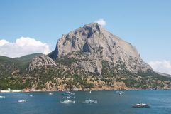 Port with mountains background. Ships Royalty Free Stock Photo