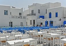 Port of Naoussa, Paros, Cyclades islands, Greece. Blue tables and chairs at the Port of Naoussa, Paros, Cyclades islands, Greece Royalty Free Stock Photography