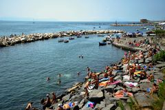 The port of Naples with boats and people getting tanned , Italy Stock Photo