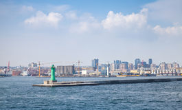 Port of Naples, cityscape with green lighthous Royalty Free Stock Photos