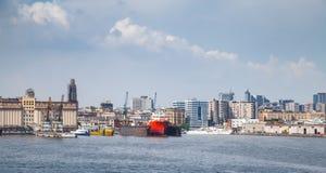 Port of Naples, coastal cityscape with cargo ships Stock Photo