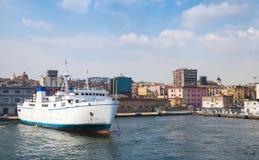 Port of Naples, coastal view with white ferry Stock Image
