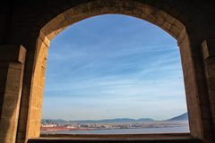 The port of Naples framed by the old wall of Castel dell`Ovo Stock Photos