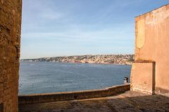 The port of Naples framed by the old wall of Castel dell`Ovo Royalty Free Stock Photo