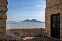 The port of Naples framed by the old wall of Castel dell`Ovo Stock Photo