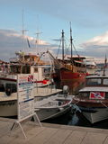 The port with new and old marina boats against cloudy sky, Croatia royalty free stock image