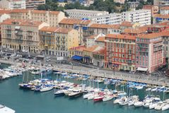 Port of Nice, marina, harbor, water transportation, port. Port of Nice is marina, port and boat. That marvel has harbor, city and watercraft and that beauty royalty free stock photos