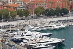 Port of Nice, marina, water transportation, boat, harbor. Port of Nice is marina, harbor and watercraft. That marvel has water transportation, dock and yacht and royalty free stock photo