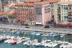 Port of Nice, marina, harbor, water transportation, port. Port of Nice is marina, port and boat. That marvel has harbor, dock and city and that beauty contains royalty free stock image