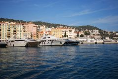 Port of Nice, marina, waterway, sea, water. Port of Nice is marina, water and sky. That marvel has waterway, harbor and dock and that beauty contains sea, water royalty free stock images