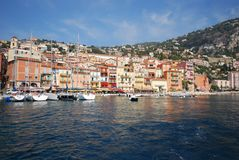 Port of Nice, sky, harbor, sea, waterway. Port of Nice is sky, waterway and city. That marvel has harbor, town and coast and that beauty contains sea, water and royalty free stock photos