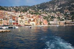 Port of Nice, Villefranche-sur-Mer, sea, body of water, coast, sky. Port of Nice, Villefranche-sur-Mer is sea, sky and city. That marvel has body of water, water stock photo