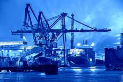 Port at night. Container ship in port at night - Shipping concept Royalty Free Stock Photography