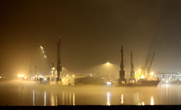 Port at night and fog Stock Photography