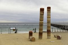 Port Noarlunga Beach with Jetty and Guildhouse art statue, ominent. Beach and Jetty in the Background. royalty free stock images