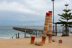 The Port Noarlunga Jetty with the abstract artwork on the foreshore in South Australia on 23rd August 2018 stock image
