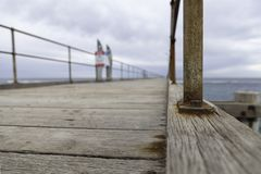 Port Noarlunga Jetty with cloud and sea. stock photography