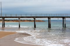 The Port Noarlunga Jetty located in South Australia with Southport in the background on the 23rd August 2018 royalty free stock images