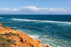 The Port Noarlunga Jetty in rough seas from the northern cliff f. Ace in South Australia on the 6th September 2018 stock photos