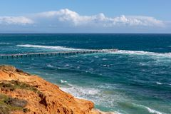 The Port Noarlunga Jetty in rough seas from the northern cliff f. Ace in South Australia on the 6th September 2018 royalty free stock photography
