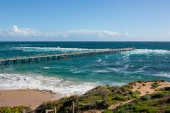The Port Noarlunga Jetty in rough seas from the northern cliff f. Ace in South Australia on the 6th September 2018 royalty free stock photo