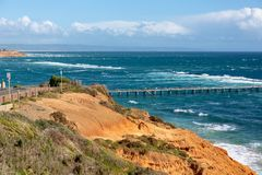 The Port Noarlunga Jetty in rough seas from the northern cliff f. Ace in South Australia on the 6th September 2018 stock photography