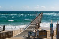 The Port Noarlunga Jetty with rough seas and people fishing in S. Outh Australia on the 6th September 2018 stock image