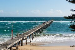 The Port Noarlunga Jetty with rough seas and people fishing in S. Outh Australia on the 6th September 2018 stock images