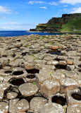 Port Noffer and the Towering Antrim Coastline from Giants Causeway. Antrim Coastline, Northern Ireland. The Giants causeway is the most popular tourist royalty free stock images