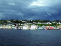 Port of Oban, Scotland. McCaig's Tower sets atop the highest hill in Oban, Scotland rendering beautiful views of this lovely port which is known for it's Royalty Free Stock Photography