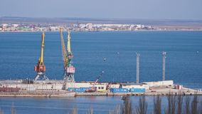 Port by the ocean with large cranes.  stock footage