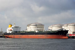 Port oil tanker silo. Oil tanker moored at an oil terminal Stock Photography