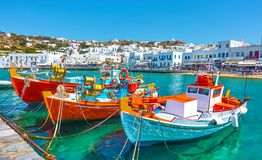 Port with old fishing boats. And the waterfront in Mykonos Islang, Greece Royalty Free Stock Photo