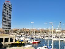 Port Olympic in Barcelona - Spain. View of Port Olympic in Barcelona. Torre Mapfre and Hotel Art Barcelona are the two skyscrapers in the background Stock Photos