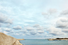 Port of Ostuni, blue sea, sky and white clouds, Apulia, Italy Stock Images