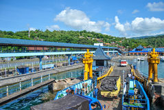 Port in Padang Bay. Cars moving from moored ferry Royalty Free Stock Photos