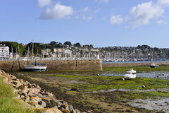 Port of Perros-Guirec in France. Port of Perros-Guirec at low tide, a commune in the Côtes-d'Armor department in Brittany in northwestern France Stock Photo