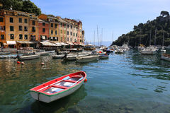 Port of Portofino in Italy. Fishing vessels in the port of Portofino with coloured houses in the background Royalty Free Stock Images