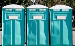 Port-a-potties in a row outdoors Stock Images