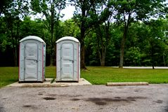 Port A Potty. A pair of porta potties in a local area public park Royalty Free Stock Photo