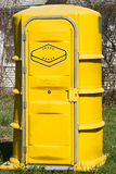 Port a Potty. Yellow Port a potty at a construction site stock images