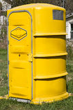 Port a Potty. Yellow Port a potty at a construction site Stock Photography