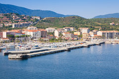 Port of Propriano, South region of Corsica. Island, France. Pier and coastal cityscape, sea view Royalty Free Stock Images